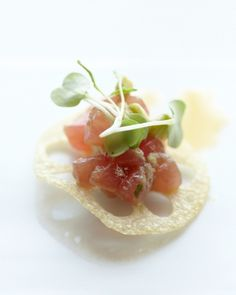 Tuna tartare heaped on delicate slices of lotus root