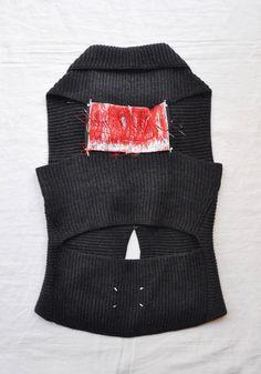MAISON MARTIN MARGIELA, KNIT VEST: this is the back of a cut-out knit vest.