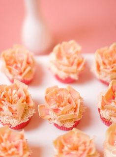 peach floral cupcakes   For more inspiration visit www.raspberrywedding.com