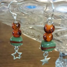 "1 4/4"" Star Drop Earrings made with handmade triangle beads and translucent seed beads. Sterling.  Perfect for Mother's Day with green and pumpkin colors."