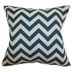 Add a bold pop of style to your sofa or favorite reading nook with this eye-catching cotton pillow, showcasing a chevron motif in blue. Made in the USA.... Joss & Martin