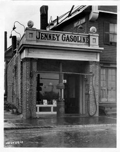 Jenney Gasoline.Notice the hose off to the right side?Odd.
