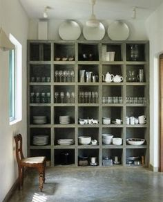 12 Concrete Interiors: Concrete cubbies might not be your first choice for storing porcelain, but the chunky concrete shelving unit is gorgeous. The floor in the kitchen of this house in Sri Lanka, by architect Geoffrey Bawa, is polished concrete too. Kitchen Shelves, Kitchen Pantry, Kitchen Storage, Open Pantry, Pantry Storage, Dish Storage, Kitchen Dishes, Cubicle Storage, Glass Shelves