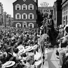 JFK addresses crowds in Lancaster PA town square. Notice the school girl's boaters hats.