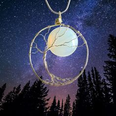This handmade Tree and Moon necklace is a stunning twist on the classic Tree of Life, loved by many. This unique wire wrapped tree pendant with a beautiful Opalite moon is a lovely gift for her. Nature lovers, celestial, lunar, moon and boho style love. Tree Of Life Necklace, Moon Necklace, Tree Of Life Pendant, Life Design, Wiccan, Sterling Silver Chains, Gifts For Her, Crafts, Full Moon