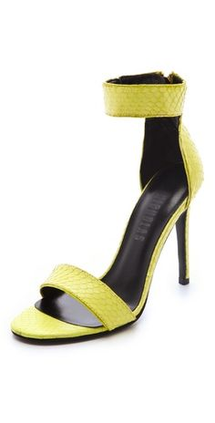 These Nicholas 'Jasmina' yellow snake sandals will add a sexy pop of color to any ensemble $259, get it here: http://rstyle.me/~5OaM