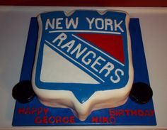 New York Rangers cake! Half vanilla and chocolate filled with whipped chocolate and hazelnut frosting.