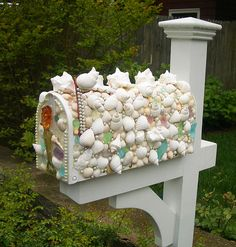 Mailbox with shells, sea glass and pearls.