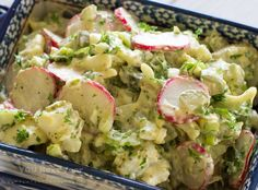 Old fashioned potato salad with new potatoes, red radish, pickles ...