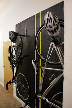 Painted an area to hang our bikes. Black metallic paint with yellow duct tape lines.