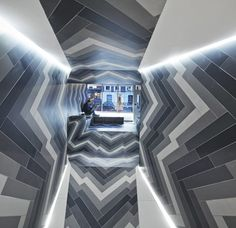 Pulsate by Lily Jencks and Nathanael Dorent. Architects installed porcelain tiles in four different monochrome shades across every surface inside the Capitol Designer Studio, a small tile showroom in London's Primrose Hill.Drawing inspiration from the mind-boggling images of Op Art and Gestalt psychology, the tiles are laid out in a zigzagging pattern that warps perspective at the back of the space