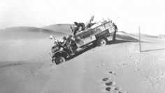 With guns covered, an F30 Ford navigates a sand dune. The pole may mark the border between Egypt and Libya. Note the photographers foot steps...