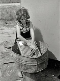 "Texas Laundress: February 1939. ""Twelve-year-old girl who keeps house in a trailer for her three brothers who are migrant workers, near Harlingen, Texas."" 35mm nitrate negative by Russell Lee"