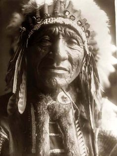Here for your enjoyment is an exciting photograph of Red Dog Shunka Luta, a Sioux Indian. It was made in 1907 by Edward S. Curtis.    The photo illustrates a Head-and-shoulders portrait of a Dakota Sioux man with a Feather Head dress.    We have compiled this collection of photos mainly to serve as a vital educational resource. Contact curator@old-picture.com.