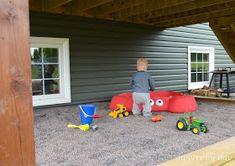 Slippers by Day: DIY Sandbox Beneath a Raised Deck