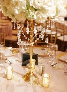 Crystal beads add so much sophistication to floral arrangements! How glamorous! Photographer: Desi Baytan