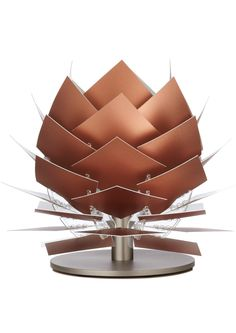 This eye-catching PineApple XS Low Table Lamp by Dyberg Larsen has been beautifully crafted by prestigious Scandinavian designer Frank Kerdil.  A minimalistic, beautiful and elegant lamp.