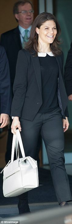 The 37-year-old looked casually chic in smart black suit trousers, a pussy-bow collared blouse, black jumper and blazer and was joined by her husband Prince Daniel, Duke of Vastergotland,