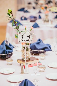 mason jar, books, postcard table number - wedding centerpiece. Photo Credit: We Are Diamond Eyes Photography.