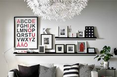 grey, black, white and red art wall (ikea)