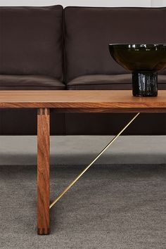 In classic Børge Mogensen style, the BM67 Coffee Table is a functionally-driven design with very few components. Starting with a solid wood frame and a sledge base, where the exposed construction underneath is part of its appeal – featuring stretchers in raw brass, which will patinate beautifully over time #fredericiafurniture #BM67 #børgemogensen #interiordesign #danishdesign #scandinaviandesign #livingroomdecor #craftedtolast #modernoriginals #coffeetable #coffeetables Hotel Lobby, Danish Design, Scandinavian Design, Living Room Decor, Solid Wood, Interior Design, The Originals, Coffee Tables, Classic