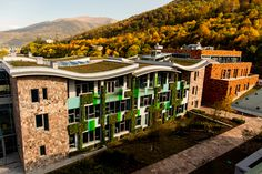 m² of Green Roof and m² of vertical living walls – the United World College (UWC) in Dillijan (Copyright Tim Flynn) Sustainable Development, London, Sustainability, Mansions, House Styles, Green, Design, Living Walls