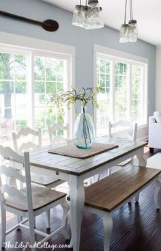 Kitchen Living Room Summer Home Tour - The Lilypad Cottage; color and simplicity for breakfast nook. - Summer Home Tour, lots of fun color and summer touches in this lake home tour. Farmhouse Table, Country Farmhouse, Farmhouse Decor, Kitchen Country, Kitchen White, Farmhouse Design, Kitchen With Blue Walls, Kitchen Colors, Home Fashion