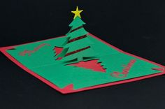 Easy Christmas Tree Pop Up Card. Please visit my website for more pop up card tutorials and templates. This is a very simple Christmas tree pop up card that anyone can make. You can be creative and decorate it in your own unique way. 3d Christmas Tree Card, Christmas Tree Template, Christmas Pops, Homemade Christmas Cards, Christmas Crafts For Kids, Xmas Crafts, Simple Christmas, Handmade Christmas, Christmas Decorations