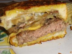 Here with this grilled cheeseburger on steroids, you'll find two of the most popular hot sandwiches rolled into one!