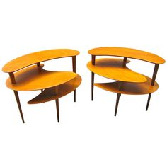 A Pair Of Side Tables In The Style Of John Keal For Brown Saltman