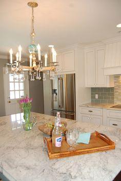 I like this granite for the kitchen countertops -- Glacier White granite and cabinets
