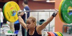 lely burgos (horizontal-x3) 1ra mujer puertorriqueña en competir en levantamiento de pesas en los juegos olímpicos.
