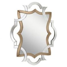 """Wall mirror with an openwork Baroque-inspired frame.           Product: Wall mirror    Construction Material: Mirrored glass   Color: Gold and silver     Features:   Soft contemporary or casual lifestyle  Two-toned palette         Dimensions:   41.75"""" H x 32.75"""" W"""