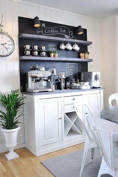 I like the general look of this coffee bar with the storage and open shelves but I would want it and the shelves to match the kitchen cupboards and I would not have the chalk back splash.
