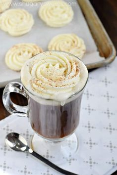 Whip up a batch of this delicious Frozen Eggnog Whipped Cream to add to your favorite hot beverage. Whether it's coffee, cocoa or eggnog, this delicious whipped cream is ready in the freezer! Köstliche Desserts, Best Dessert Recipes, Frozen Desserts, Tea Recipes, Coffee Recipes, Holiday Recipes, Delicious Desserts, Holiday Drinks, Holiday Desserts