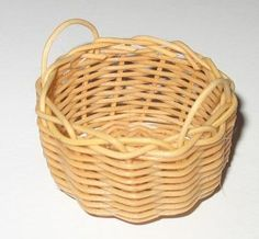 Jane Harrop uses one of the traditional basket making materials, centre cane, to weave a log basket. ...