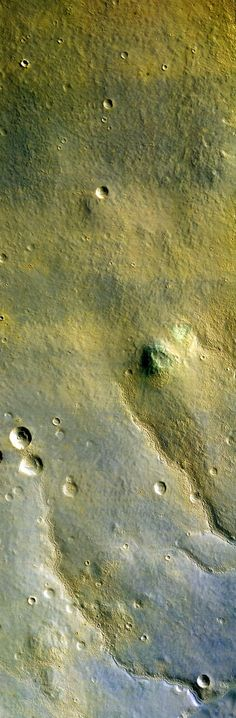 This is the first color image of Mars from the High Resolution Imaging Science Experiment (HiRISE) on NASA's Mars Reconnaissance Orbiter. Seen in the image is what appears to be early-morning fog in the atmosphere. Large-scale streaks are due to the action of wind on surface materials. The blankets of material ejected from the many small fresh craters are generally brighter and redder than the surrounding surface, but a few are darker and less red