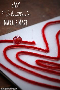 A homemade Valentine themed marble maze that works on fine and visual motor skills in kids and is pretty, fun and easy to do!