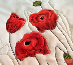 'Quilt first - Paint later' Inktense on fabric video tutorial. These poppies were created using the 'Quilt first-Paint later' technique. See my video tutorial (Part 2 Inktense on Fabric) for more http://www.deborahwirsu.com/2014/05/11/inktense-for-quilters-quilt-then-paint-video-tutorial-part-2/