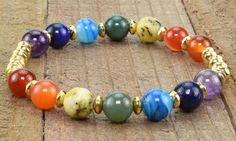 These stretchy bracelets are made with genuine 8mm gemstone beads representing the 7 chakras and feature stainless steel accents