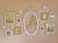 flowers on the wall, cut tapestry circled by a painted frame...good ideas of display