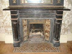 Aesthetic Movement faux-painted slate fireplace. - much like the fireplace from the old house.