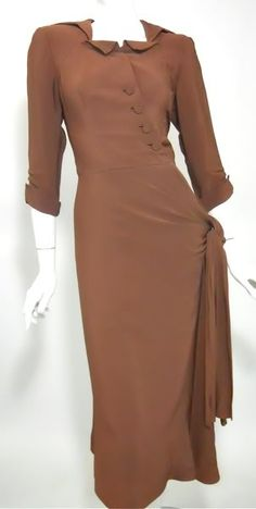 40s dress vintage dress, designed by Adele Simpson.  Cinnamon brown rayon dress.  Three quarter length sleeves, square neckline with pert collar.  Button up front fastens diagonally.  The skirt is bias cut and has a sash accent at the hip.  Below the knee hemline.