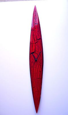 Stunning handmade glass wall clock. Made in a striking large 74cm design in an eye catching pillar box red glass with a contrasting black crackels design. Width is 10cm at its widest and length is a long 74cm. This clock is handmade and to a high design quality, sure to draw comments from everyone who sees it! (You can carefully remove the mechanism and switch it around so the clock lies horizontal instead!!)