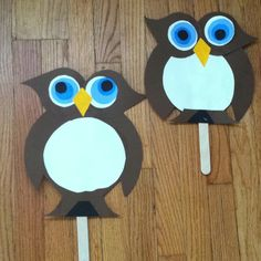 Two Owls made of card stock paper, glue, & a Popsicle stick or tongue suppressor to make them into puppets. My 4 year old had a lot of fun putting the shapes I precut together to form the owls. It's great for recognizing forms, shapes and colors as well as an animal you can teach your child about.