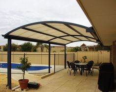 arched aluminum patio cover design to give more head room