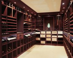 This private Luxembourg wine cellar was built in 2007 from an old wash house, so space was at a premium. The firm Degré 12 employed efficient sliding trays with LED lighting for bottles and crates, and installed a chimney for ventilation. Alcoves are decorated with artwork, such as a contemporary jade-green Buddha head based on a sixth-century design. degre12.be