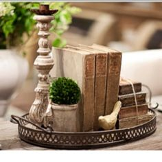 Idea for putting all the Christmas books out on a tray with greenery at the holidays.