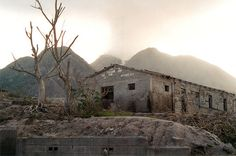 An abandoned building in Plymouth, at the base of the volcano, after it erupted