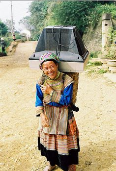 """""""It is market day.... and the TV needs to be fixed!!  Colorful big smile...of a Flower Hmong lady in Bac-Ha,  North West Vietnam"""""""